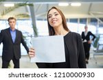 business woman with a blank... | Shutterstock . vector #1210000930