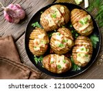 baked potatoes with bacon ... | Shutterstock . vector #1210004200