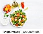 vegetable salad with chicken... | Shutterstock . vector #1210004206
