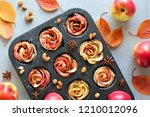 tray of apple roses baked in... | Shutterstock . vector #1210012096