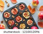 tray of apple roses baked in... | Shutterstock . vector #1210012096