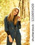 blonde woman in blue denim... | Shutterstock . vector #1210051420
