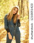 blonde woman in blue denim... | Shutterstock . vector #1210051423