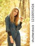 blonde woman in blue denim... | Shutterstock . vector #1210051426