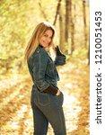 blonde woman in blue denim... | Shutterstock . vector #1210051453