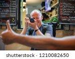 photographer taking photos of... | Shutterstock . vector #1210082650