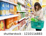 young asian woman with basket... | Shutterstock . vector #1210116883