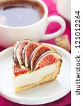 Delicious cake with fresh figs and cup of coffee. - stock photo
