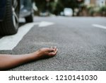 person lying on the ground... | Shutterstock . vector #1210141030