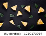 fresh pineapple on black wood ... | Shutterstock . vector #1210173019