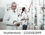 director of drugstore. mature...   Shutterstock . vector #1210181899