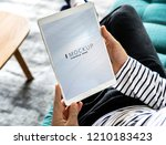 man using a tablet with a... | Shutterstock . vector #1210183423