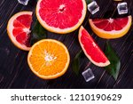 orange and grapefruit juice on... | Shutterstock . vector #1210190629