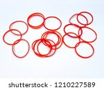 rubber band of red on a white... | Shutterstock . vector #1210227589