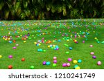 an easter egg hunt with...   Shutterstock . vector #1210241749