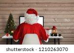 Santa Claus Work On A Computer...
