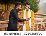 two indian stylish mans friends ...   Shutterstock . vector #1210265920