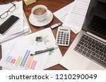 office desk full with documents ... | Shutterstock . vector #1210290049