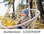 cute kid swinging in a hanging... | Shutterstock . vector #1210291039