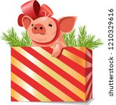 funny pig in a gift box. symbol ... | Shutterstock .eps vector #1210329616