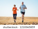 senior woman and man running or ... | Shutterstock . vector #1210365859