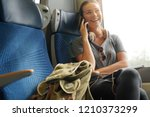 young woman travelling on... | Shutterstock . vector #1210373299