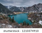 late autumn at the mountain lake | Shutterstock . vector #1210374910