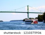 a cruise boat approaches the... | Shutterstock . vector #1210375936