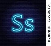 blue neon letters  font on dark ... | Shutterstock .eps vector #1210381699