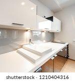 modern kitchen interior. inside ... | Shutterstock . vector #1210404316