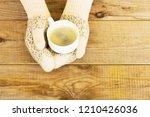 woman hands in teal gloves are... | Shutterstock . vector #1210426036