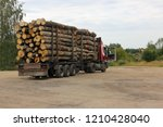 timber carrying vessel loaded... | Shutterstock . vector #1210428040