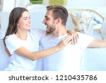 happy young couple hugging and... | Shutterstock . vector #1210435786