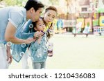 asian family is playing balloon ... | Shutterstock . vector #1210436083