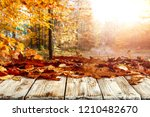 autumnal leaves on a wooden... | Shutterstock . vector #1210482670