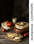 pita bread on wooden board with ...   Shutterstock . vector #1210492690