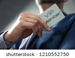vip member card holded by an... | Shutterstock . vector #1210552750