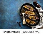 baked eggplants in a skillet... | Shutterstock . vector #1210566793