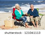 senior couple sitting on beach... | Shutterstock . vector #121061113