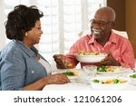 senior couple enjoying meal at... | Shutterstock . vector #121061206