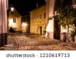 narrow cobbled street in old... | Shutterstock . vector #1210619713