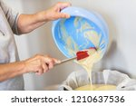 senior woman hands pouring... | Shutterstock . vector #1210637536