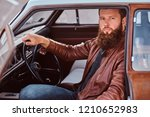 bearded male dressed in brown... | Shutterstock . vector #1210652983