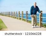 Senior Man Walking Along Path...