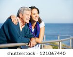 senior man with adult daughter... | Shutterstock . vector #121067440
