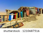 stores selling souvenirs in the ... | Shutterstock . vector #1210687516
