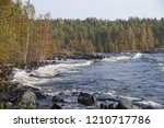rocky shore of the lake bay ... | Shutterstock . vector #1210717786
