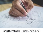 Small photo of Storyboard or storytelling drawing creative for movie process pre-production media films script for video editors, Student hand writing graphic organizer in form of illustrations displayed in sequence