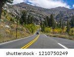 driving through the sierra... | Shutterstock . vector #1210750249