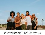 group of diverse friends... | Shutterstock . vector #1210779439